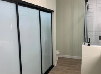 7. Black frames, frosted glass, 3 panels, 120w by 96h $1823