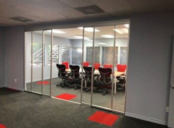 Glass sliding panels, conference room, silver frames, clear glass