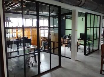 L-Shaped Glass Office